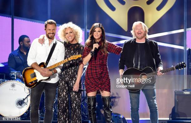 Musicians Jimi Westbrook Kimberly Schlapman Karen Fairchild and Philip Sweet of Little Big Town perform onstage during the 2017 iHeartCountry...