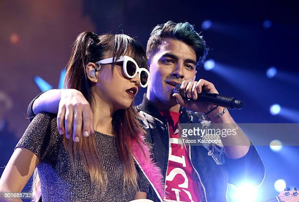 Musicians JinJoo Lee and Joe Jonas of the band DNCE perform onstage during 1035 KISS FM's Jingle Ball 2015 presented by Capital One at Allstate Arena...