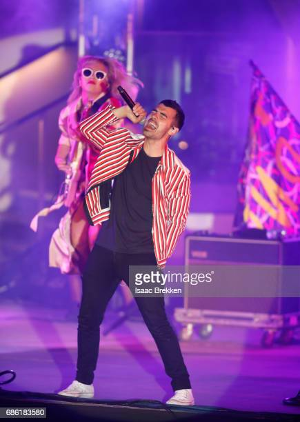 Musicians JinJoo Lee and Joe Jonas perform on the second night of CBS RADIO's 'SPF' concert at The Boulevard Pool at The Cosmopolitan of Las Vegas on...