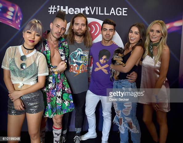 Musicians JinJoo Lee Cole Whittle Jack Lawless and singer Joe Jonas of DNCE and television personalities Ashley Iaconetti and Lauren Bushnell attend...