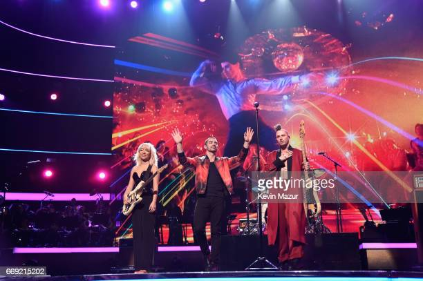 Musicians JinJoo Lee Joe Jonas and Cole Whittle of musical group DNCE perform onstage during 'Stayin' Alive A GRAMMY Salute To The Music Of The Bee...