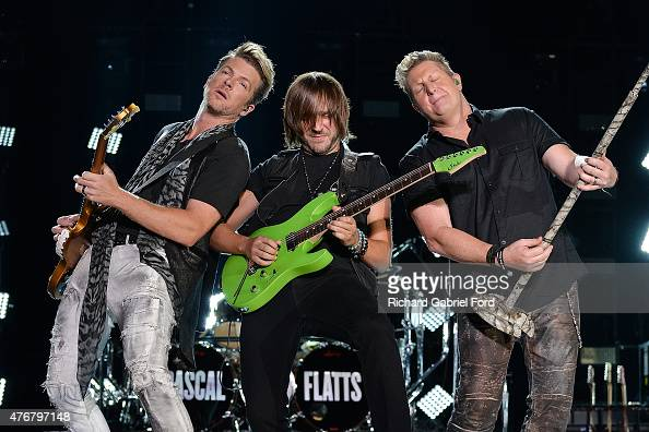 Musicians Joe Don Rooney and Gary LeVox of Rascal Flatts perform onstage during the 2015 CMA Festival on June 11 2015 in Nashville Tennessee