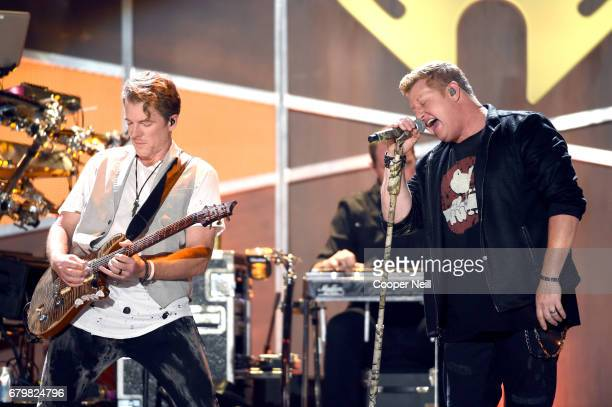 Musicians Joe Don Rooney and Gary LeVox of Rascal Flatts perform onstage during the 2017 iHeartCountry Festival A Music Experience by ATT at The...