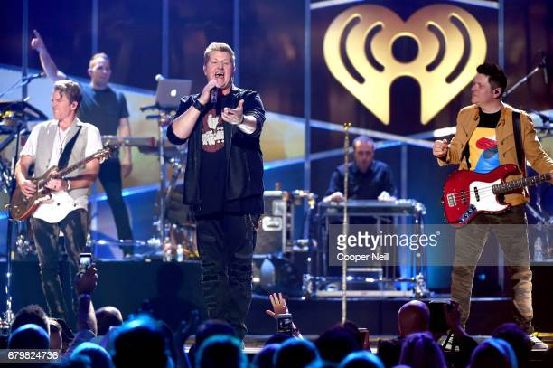 Musicians Joe Don Rooney Gary LeVox and Jay DeMarcus of Rascal Flatts perform onstage during the 2017 iHeartCountry Festival A Music Experience by...