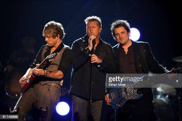 Musicians Joe Don Rooney Gary LeVox and Jay DeMarcus of the band Rascal Flatts onstage during the 43rd annual Academy Of Country Music Awards held at...