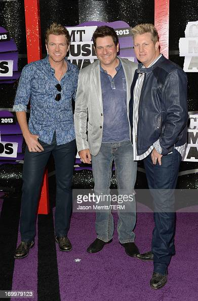 Musicians Joe Don Rooney Jay DeMarcus and Gary LeVox of Rascal Flatts attend the 2013 CMT Music awards at the Bridgestone Arena on June 5 2013 in...