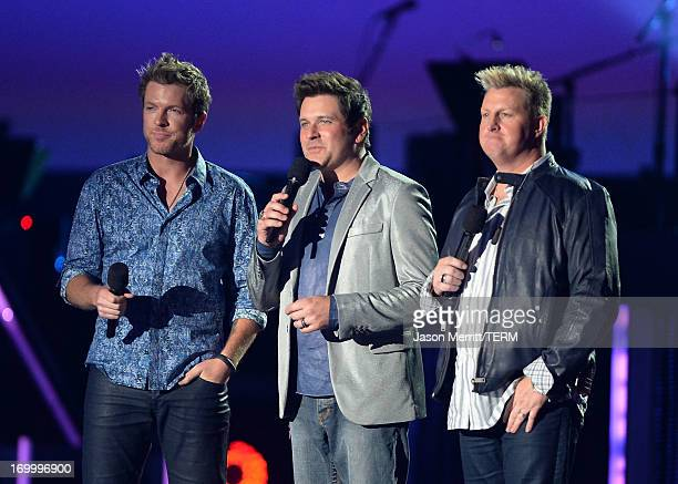 Musicians Joe Don Rooney Jay DeMarcus and Gary LeVox of Rascal Flatts speak onstage during the 2013 CMT Music awards at the Bridgestone Arena on June...