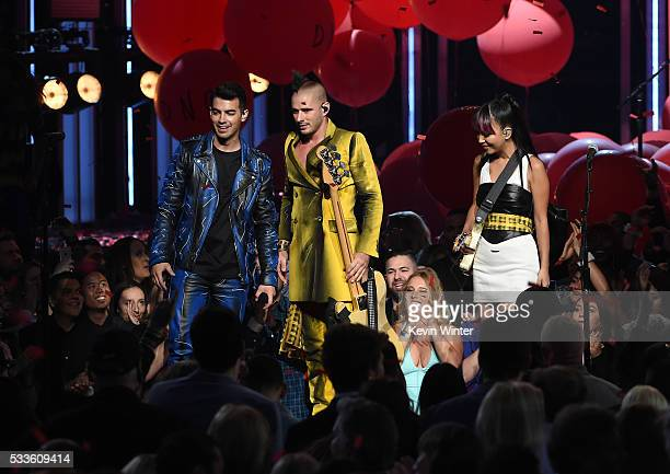Musicians Joe Jonas Cole Whittle and JinJoo Lee of DNCE perform onstage during the 2016 Billboard Music Awards at TMobile Arena on May 22 2016 in Las...