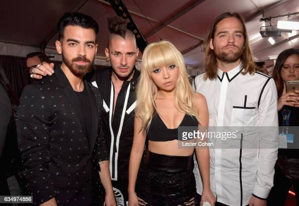 Musicians Joe Jonas Cole Whittle JinJoo Lee and Jack Lawless of DNCE attend The 59th GRAMMY Awards at STAPLES Center on February 12 2017 in Los...