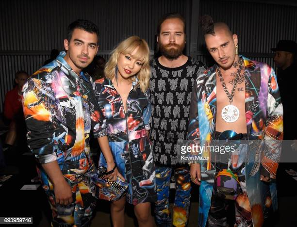 Musicians Joe Jonas JinJoo Lee Jack Lawless and Cole Whittle of DNCE attend Moschino Spring/Summer 18 Menswear and Women's Resort Collection at Milk...