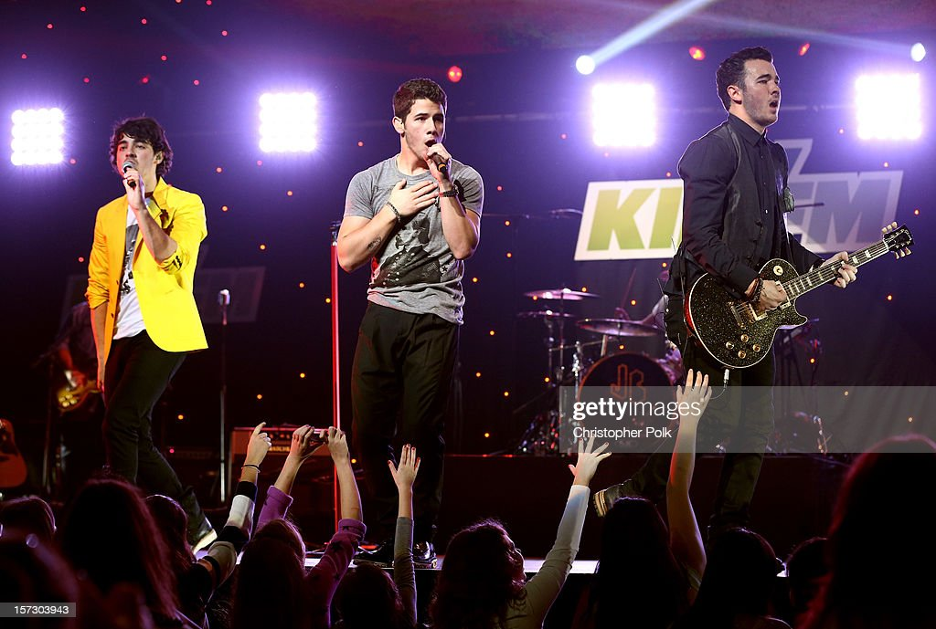 Musicians Joe Jonas Nick Jonas and Kevin Jonas of The Jonas Brothers perform onstage during KIIS FM's 2012 Jingle Ball at Nokia Theatre LA Live on...