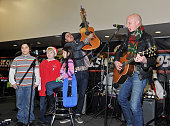 Musicians Joe King and Isaac Slade of the band The Fray perform with children at 'PLJ's 20th Annual Scott Todd's Live broadcast/auction at Blythedale...