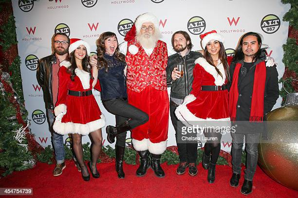 Musicians Joe Lester Nikki Monninger Brian Aubert and Chris Guanlao of Silversun Pickups attend the ALTimate Rooftop Christmas Party at W Hollywood...