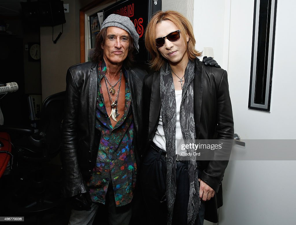 Musicians Joe Perry and Yoshiki visit the SiriusXM Studios on October 6, 2014 in New York City.