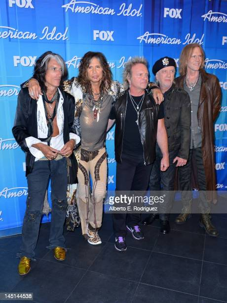 Musicians Joe Perry Steven Tyler Joey Kramer Brad Whitford and Tom Hamilton pose in the press room during Fox's 'American Idol 2012' Finale Results...