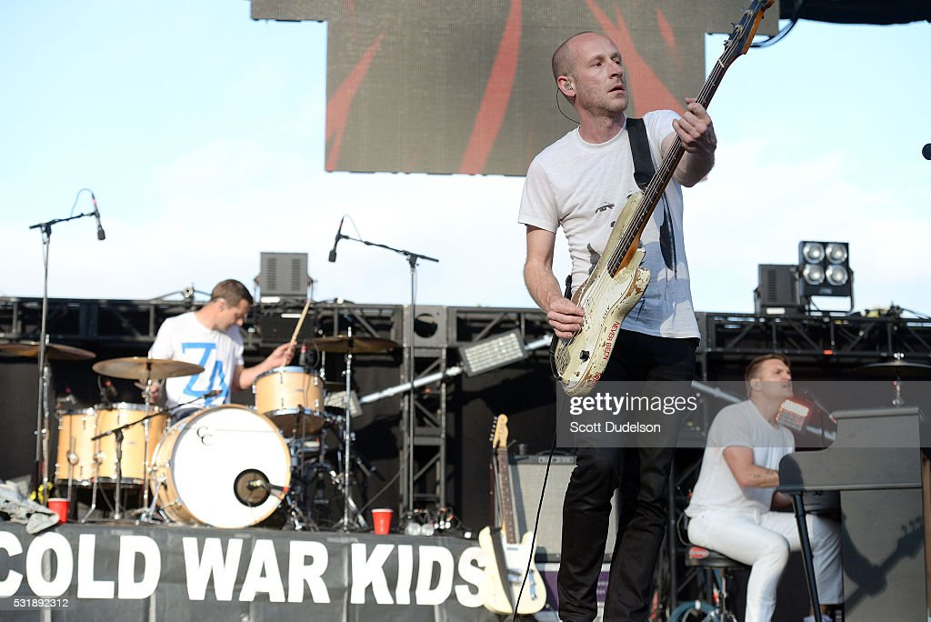 Musicians Joe Plummer Matt Maust and Nathan Willett of the band Cold War Kids perform onstage during KROQ's Weenie Roast at Irvine Meadows...