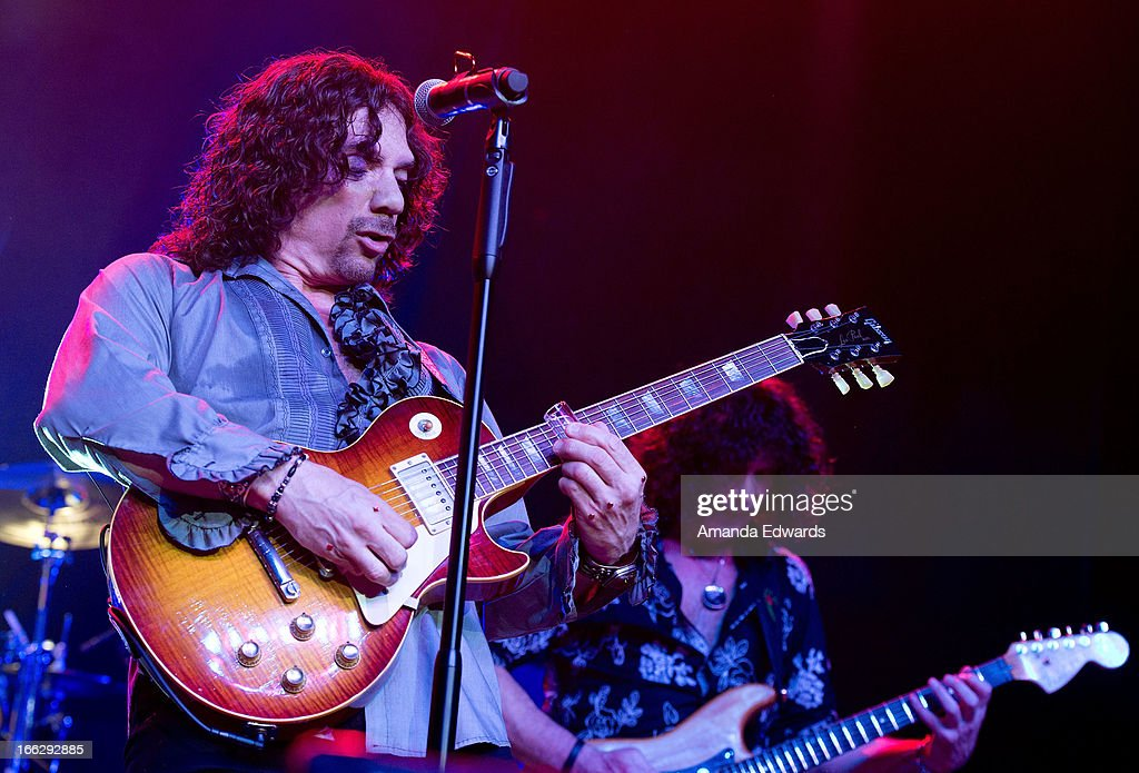 Musicians Joe Retta (L) and Stuart Smith of the band Heaven And Earth perform onstage at the Heaven And Earth 'Dig' world premiere album release party at The Fonda Theatre on April 10, 2013 in Los Angeles, California.