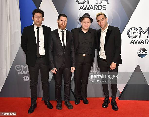 Musicians Joe Trohman Andy Hurley Patrick Stump and Pete Wentz of Fall Out Boy attend the 49th annual CMA Awards at the Bridgestone Arena on November...