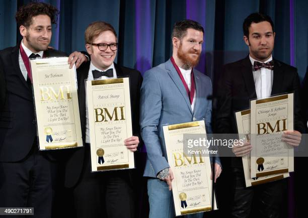 Musicians Joe Trohman Patrick Stump Andy Hurley and Pete Wentz of Fall Out Boy accept the 2014 BMI Pop Award onstage at the 62nd annual BMI Pop...
