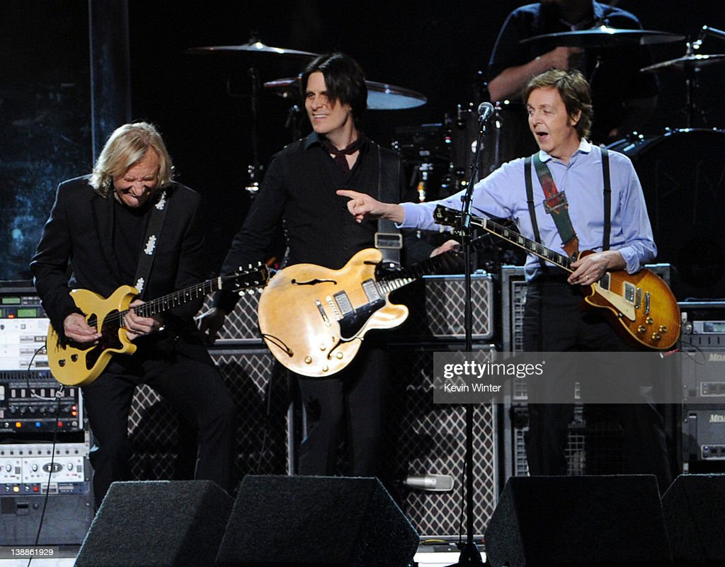 Musicians <a gi-track='captionPersonalityLinkClicked' href=/galleries/search?phrase=Joe+Walsh+-+Singer&family=editorial&specificpeople=223888 ng-click='$event.stopPropagation()'>Joe Walsh</a>, <a gi-track='captionPersonalityLinkClicked' href=/galleries/search?phrase=Rusty+Anderson&family=editorial&specificpeople=4391924 ng-click='$event.stopPropagation()'>Rusty Anderson</a> and <a gi-track='captionPersonalityLinkClicked' href=/galleries/search?phrase=Paul+McCartney&family=editorial&specificpeople=92298 ng-click='$event.stopPropagation()'>Paul McCartney</a> perform onstage at the 54th Annual GRAMMY Awards held at Staples Center on February 12, 2012 in Los Angeles, California.