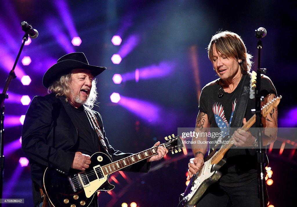 Musicians John Anderson (L) and Keith Urban perform onstage during ACM Presents: Superstar Duets at Globe Life Park in Arlington on April 18, 2015 in Arlington, Texas.
