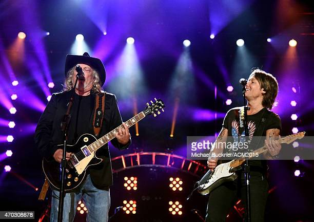 Musicians John Anderson and Keith Urban perform onstage during ACM Presents Superstar Duets at Globe Life Park in Arlington on April 18 2015 in...