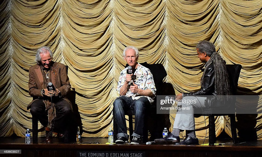 Musicians John Densmore and Robby Krieger and Film Independent at LACMA film curator Elvis Mitchell attend the Film Independent at LACMA Presents An Evening With The Doors event at Bing Theatre At LACMA on December 5, 2013 in Los Angeles, California.