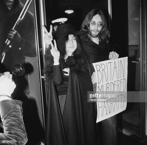 Musicians John Lennon and Yoko Ono carrying a 'Britain Murdered Hanratty' sign at the premiere of the film 'The Magic Christian' at the Odeon...