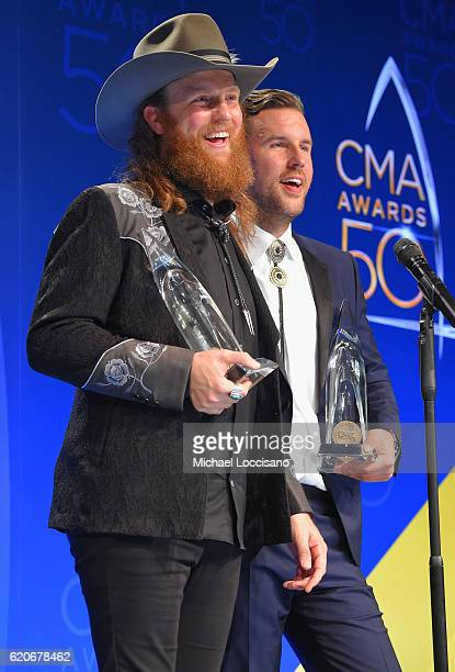 Musicians John Osborne and TJ Osborne of Brothers Osborne speak in the press room during the 50th annual CMA Awards at the Bridgestone Arena on...