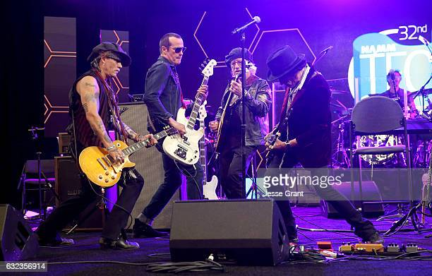Musicians Johnny Depp Robert DeLeo Brad Whitford and Joe Perry perform onstage at the TEC Awards during NAMM Show 2017 at the Anaheim Hilton on...