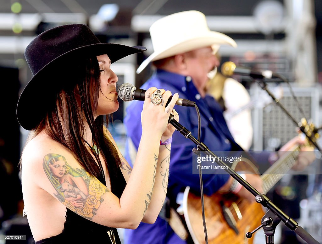 Musicians Johnny Lee (R) and Cherish Lee perform onstage during 2016 Stagecoach California's Country Music Festival at Empire Polo Club on May 01, 2016 in Indio, California.