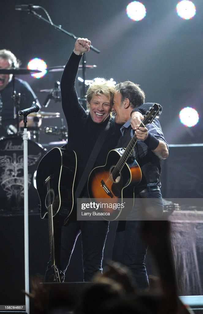 Musicians Jon Bon Jovi (L) and Bruce Springsteen perform at '12-12-12' a concert benefiting The Robin Hood Relief Fund to aid the victims of Hurricane Sandy presented by Clear Channel Media & Entertainment, The Madison Square Garden Company and The Weinstein Company at Madison Square Garden on December 12, 2012 in New York City.