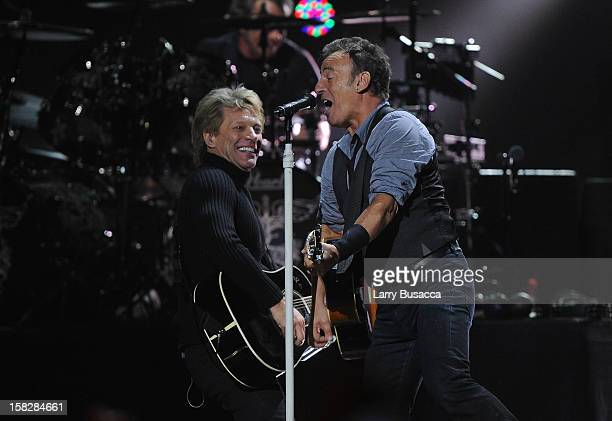 Musicians Jon Bon Jovi and Bruce Springsteen perform at '121212' a concert benefiting The Robin Hood Relief Fund to aid the victims of Hurricane...