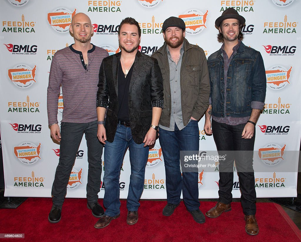 Musicians Jon Jones, Mike Eli, James Young and Chris Thompson of the Eli Young Band pose at the 'Reba and Friends Outnumber Hunger' concert event on Tuesday, March 31, 2015 in Burbank, California. Tune in starting April 17, 2015 to the 'Reba and Friends Outnumber Hunger' concert event, which officially launches the fourth annual Outnumber Hunger campaign. This collaboration between General Mills, Big Machine Label Group and Feeding America highlights the issue of hunger in America and helps provide meals to people and families in need. Reba headlines along with performances by Tim McGraw, Rascal Flatts, Florida Georgia Line, Eli Young Band and Maddie & Tae. Visit OutnumberHunger.com for local listings.