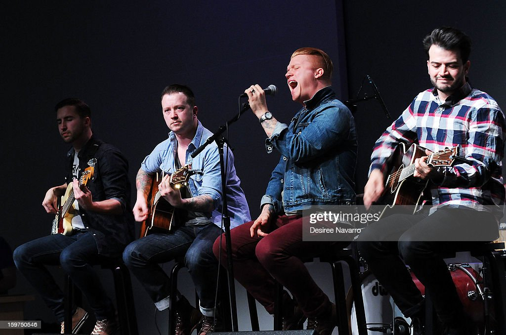 Musicians Jon Thompson, Dusty Redmon, <a gi-track='captionPersonalityLinkClicked' href=/galleries/search?phrase=Aaron+Gillespie&family=editorial&specificpeople=538897 ng-click='$event.stopPropagation()'>Aaron Gillespie</a> and Jay Vilardi of The Almost perform during Meet The Musicians at the Apple Store Soho on January 19, 2013 in New York City.