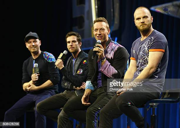 Musicians Jonny Buckland Guy Berryman Chris Martin and Will Champion of Coldplay speak onstage at the Pepsi Super Bowl Halftime Press Conference on...