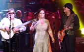 Musicians Jose Feliciano Gloria Estefan and Carlos Santana perform onstage during the 2008 Latin Recording Academy Person of the Year awards tribute...