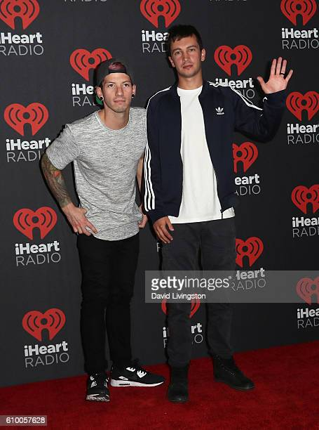 Musicians Josh Dun and Tyler Joseph of Twenty One Pilots attend the 2016 iHeartRadio Music Festival Night 1 at TMobile Arena on September 23 2016 in...