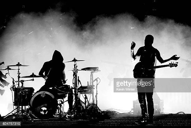 Musicians Josh Dun and Tyler Joseph of Twenty One Pilots perform onstage during the 2016 American Music Awards at Microsoft Theater on November 20...