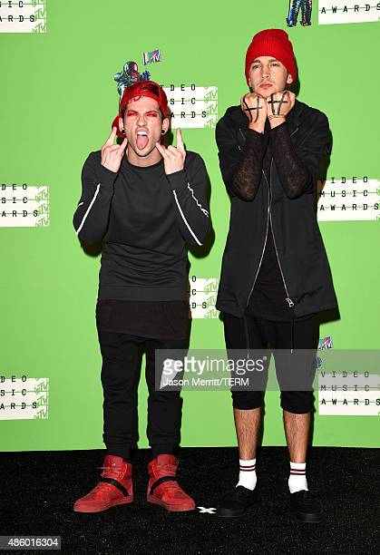 Musicians Josh Dun and Tyler Joseph of Twenty One Pilots pose in the press room at the 2015 MTV Video Music Awards at Microsoft Theater on August 30...