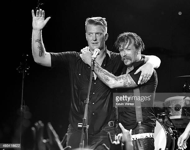 Musicians Josh Homme and Jesse Hughes of Eagles of Death Metal perform at the Teragram Ballroom on October 19 2015 in Los Angeles California
