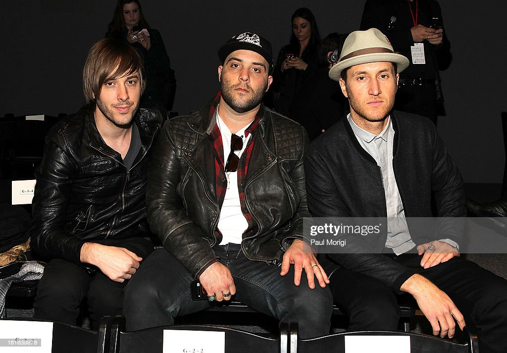 Musicians Joshua Mervin, Nathan Blumenfeld-James and Dustin Bath of Early Morning Rebel pose for a photo at Falguni & Shane Peacock during Fall 2013 Mercedes-Benz Fashion Week at The Studio at Lincoln Center on February 13, 2013 in New York City.