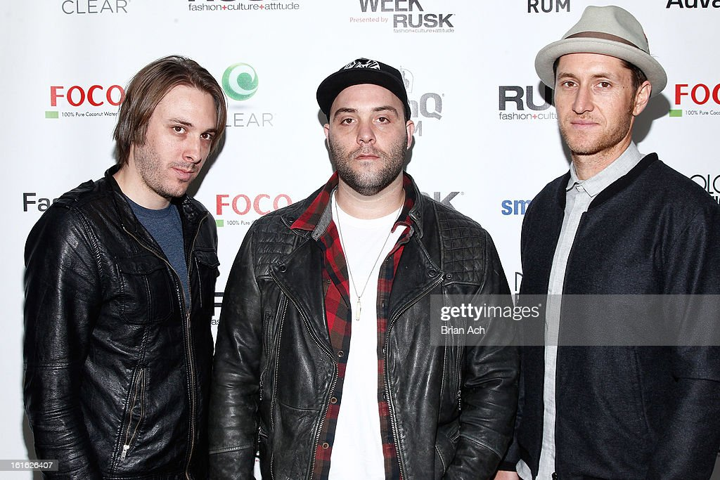 Musicians Joshua Mervin, Nathan James, and Dustin Bath of Early Morning Rebel attend Nolcha Fashion Week New York 2013 presented by RUSK at Pier 59 Studios on February 13, 2013 in New York City.
