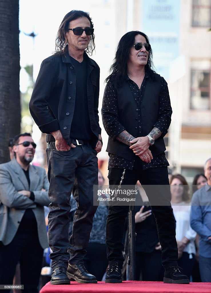 Musicians Juan Calleros and Alex Gonzalez attend a ceremony honoring Maná with the 2,573rd Star on the Hollywood Walk of Fame on February 10, 2016 in Hollywood, California.