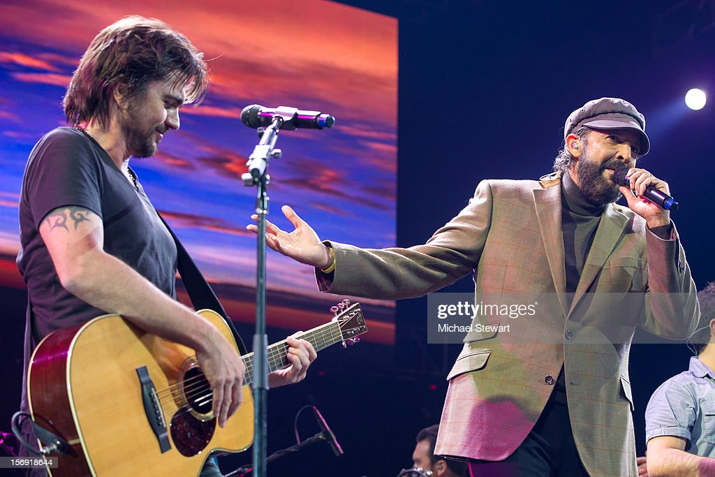 Musicians Juan Luis Guerra (L) and Juanes perform during the Hurricane Sandy Benefit concert at the Barclays Center on November 24, 2012 in the Brooklyn borough of New York City.