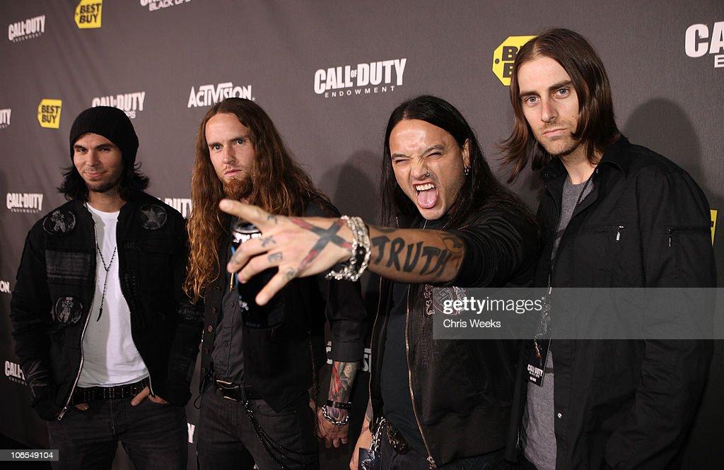 Musicians Julien Jorgensen, Dave Agoglia, Rikki Lixx, and Matt McCloskey of Rev Theory arrive at the Call Of Duty: Black Ops Launch Party held at Barker Hangar on November 4, 2010 in Santa Monica, California.