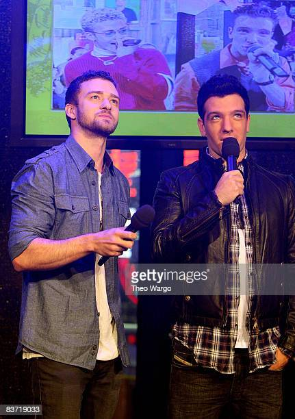 Musicians Justin Timberlake and JC Chasez speak during MTV's TRL 'Total Finale Live' at the MTV Studios in Times Square on November 16 2008 in New...