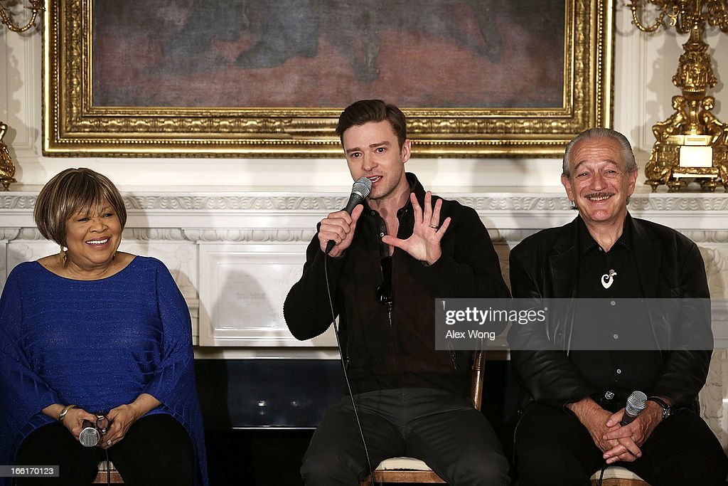 Musicians Justin Timberlake (2nd L) speaks as Charlie Musselwhite (R) and Mavis Staples (L) listen during an interactive student workshop at the State Dining Room of the White House April 9, 2013 in Washington, DC. The first lady hosted middle and high school students from across the country to take part in the workshop on 'Soulsville,