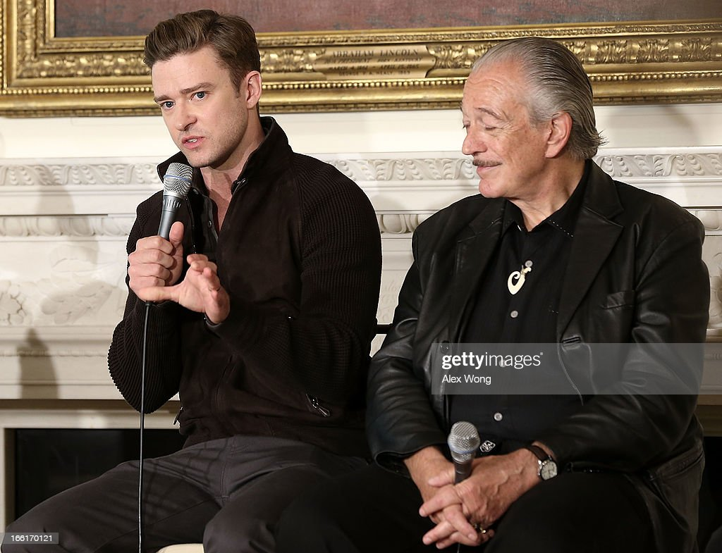Musicians Justin Timberlake (L) speaks as Charlie Musselwhite (R) listens during an interactive student workshop at the State Dining Room of the White House April 9, 2013 in Washington, DC. The first lady hosted middle and high school students from across the country to take part in the workshop on 'Soulsville,