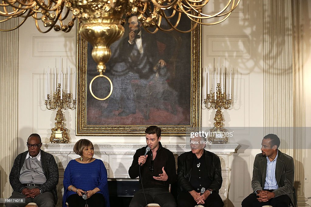 Musicians Justin Timberlake (3rd L) speaks as (L-R) Sam Moore, Mavis Staples, Charlie Musselwhite, and Ben Harper listen during an interactive student workshop at the State Dining Room of the White House April 9, 2013 in Washington, DC. U.S. first lady hosted middle and high school students from across the country to take part in the workshop on 'Soulsville,